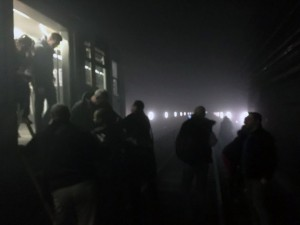 In this photo provided by EurActiv and photographed by Evan Lamos, passengers on the metro leave their carriages and walk along the tracks following an attack on the Brussels underground transport system in Brussels, Belgium, after an explosion, Tuesday, March 22, 2016. Scores of people are dead after explosions hit Brussels airport and the city's Maelbeek metro station Tuesday morning. (Evan Lamos/EurActiv, via AP)